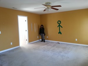 Leah in Master Bedroom next to Art